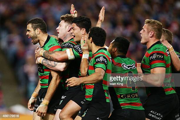 Greg Inglis of the Rabbitohs celebrates team mates after scoring his second try during the First Preliminary Final match between the South Sydney...