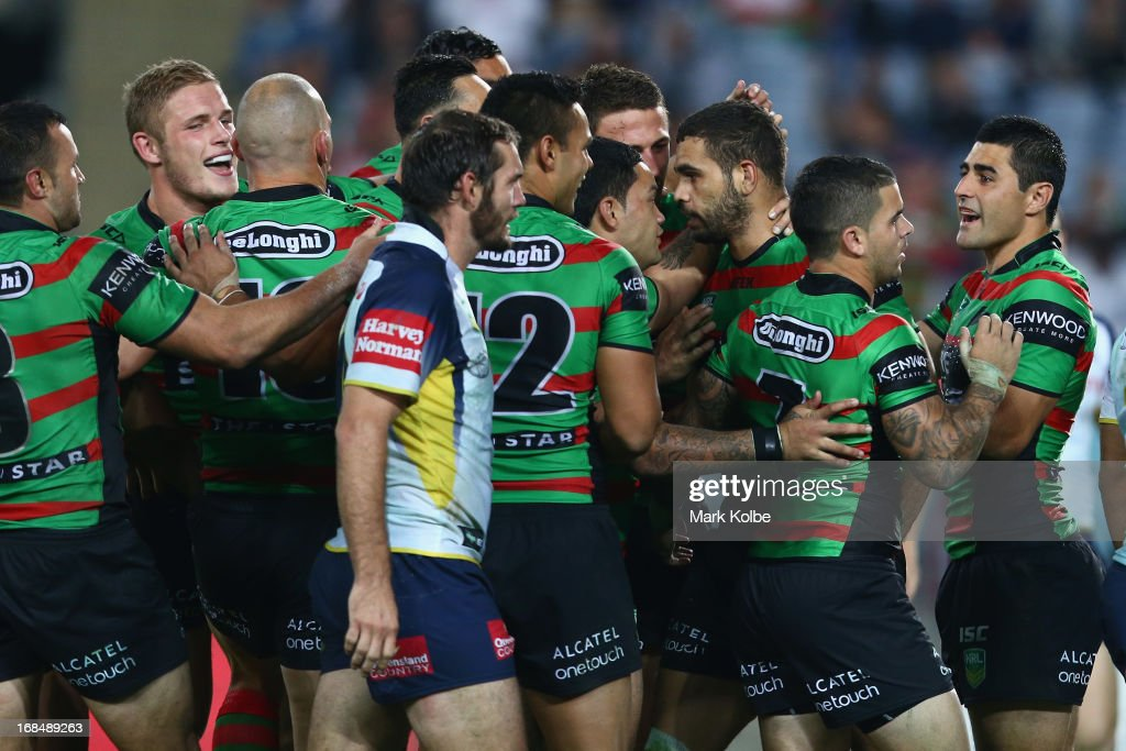 <a gi-track='captionPersonalityLinkClicked' href=/galleries/search?phrase=Greg+Inglis&family=editorial&specificpeople=597192 ng-click='$event.stopPropagation()'>Greg Inglis</a> of the Rabbitohs celebrates with his team mates after scoring a try during the round nine NRL match between the South Sydney Rabbitohs and the North Queensland Cowboys at ANZ Stadium on May 10, 2013 in Sydney, Australia.