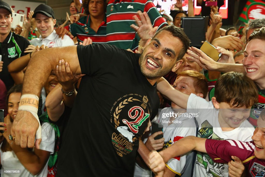 Greg Inglis of the Rabbitohs celebrates with the crowd after victory during the 2014 NRL Grand Final match between the South Sydney Rabbitohs and the Canterbury Bulldogs at ANZ Stadium on October 5, 2014 in Sydney, Australia.