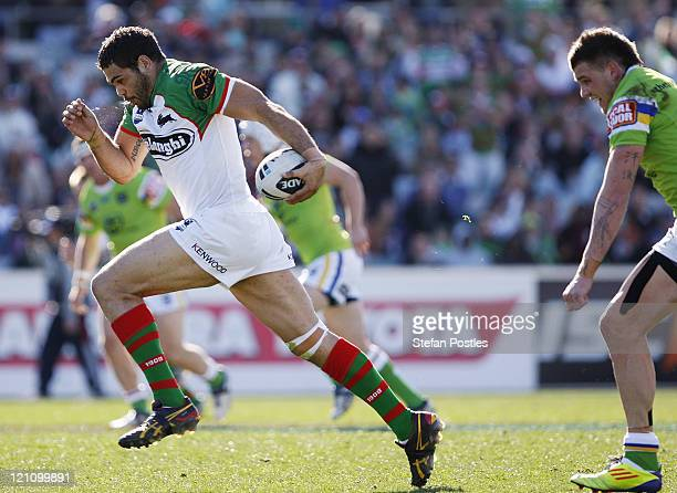Greg Inglis of the Rabbitohs intercepts a pass to run away and score a try during the round 23 NRL match between the Canberra Raiders and the South...