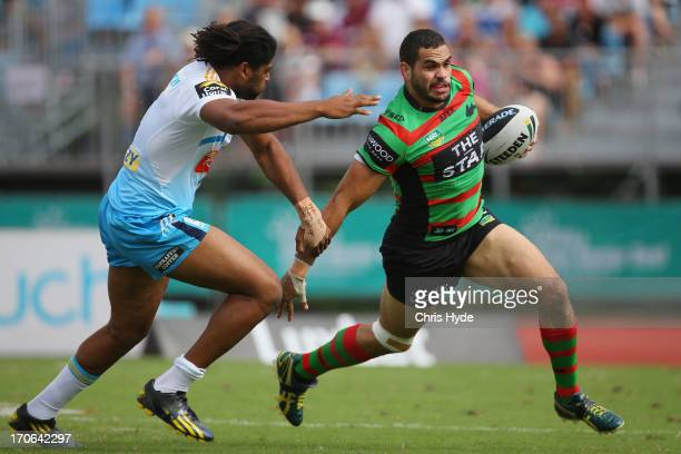 Greg Inglis of the Rabbitohs is tackled by Jamal Idris of the Titans during the round 14 NRL match between the South Sydney Rabbitohs and the Gold...