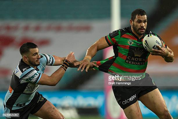 Greg Inglis of the Rabbitohs is tackled during the round 24 NRL match between the South Sydney Rabbitohs and the Cronulla Sharks at ANZ Stadium on...