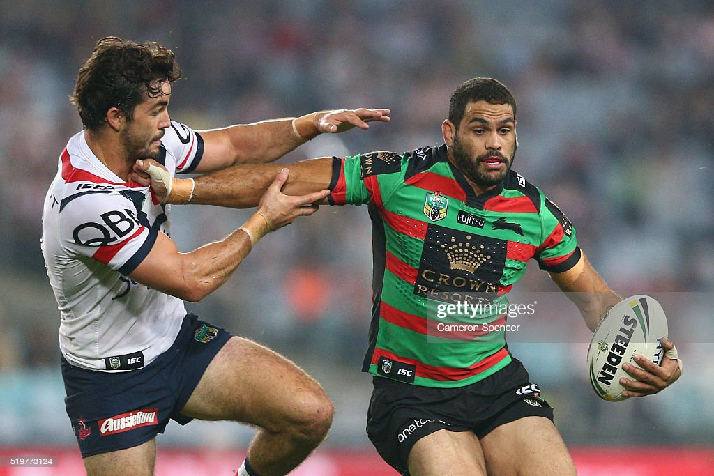 Greg Inglis of the Rabbitohs is tackled during the round six NRL match between the South Sydney Rabbitohs and the Sydney Roosters at ANZ Stadium on...