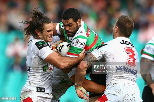 Greg Inglis of the Rabbitohs is tackled during the round three NRL match between the St George Dragons and the South Sydney Rabbitohs at Sydney...
