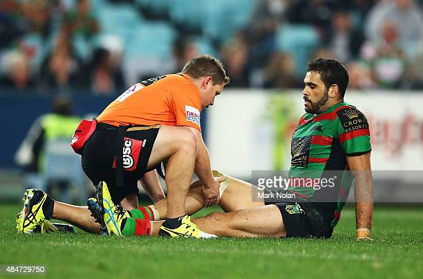 Greg Inglis of the Rabbitohs receives attention for a knee injury during the round 24 NRL match between the South Sydney Rabbitohs and the Canterbury...