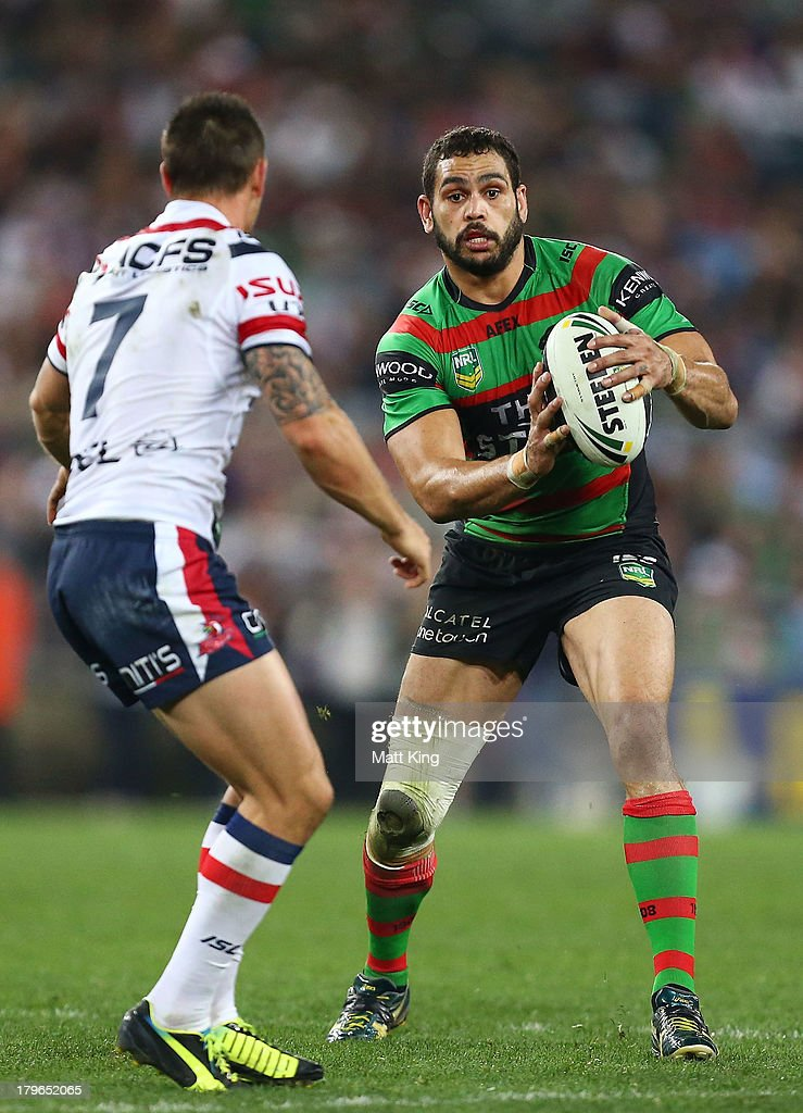 Greg Inglis of the Rabbitohs runs at Mitchell Pearce of the Roosters during the round 26 NRL match between the South Sydney Rabbitohs and the Sydney Roosters at ANZ Stadium on September 6, 2013 in Sydney, Australia.