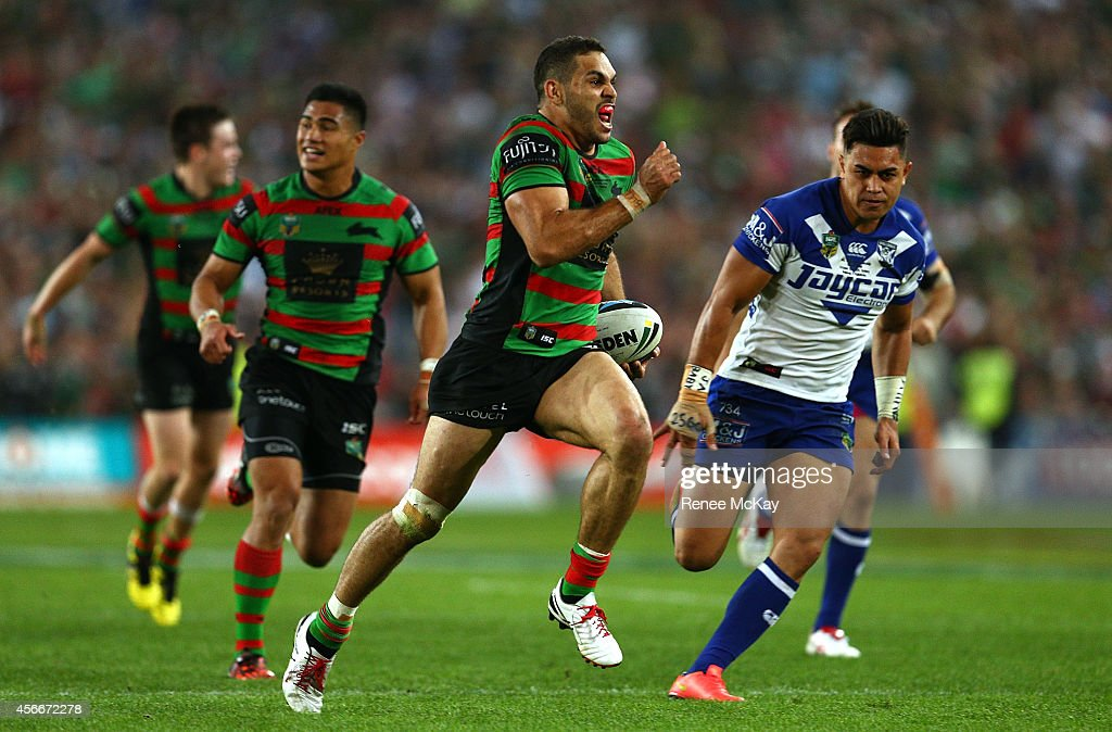 Greg Inglis of the Rabbitohs scores a try during the 2014 NRL Grand Final match between the South Sydney Rabbitohs and the Canterbury Bulldogs at ANZ...