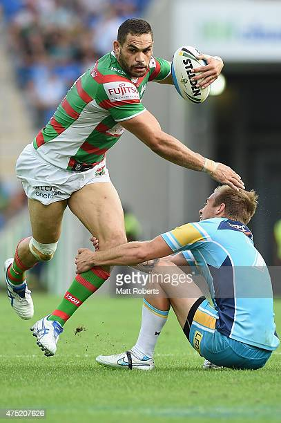 Greg Inglis of the Rabbitohs takes on the defence during the round 12 NRL match between the Gold Coast Titans and the South Sydney Rabbitohs at Cbus...