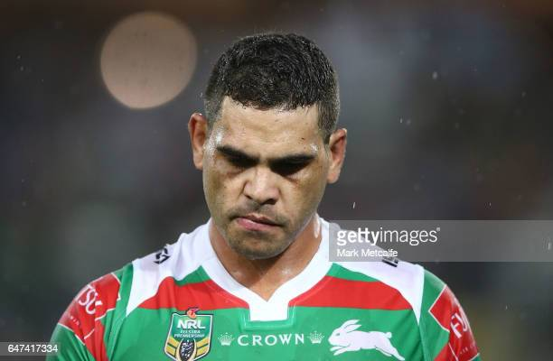 Greg Inglis of the Rabbitohs walks from the field injured during the round one NRL match between the South Sydney Rabbitohs and the Wests Tigers at...