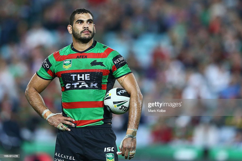 <a gi-track='captionPersonalityLinkClicked' href=/galleries/search?phrase=Greg+Inglis&family=editorial&specificpeople=597192 ng-click='$event.stopPropagation()'>Greg Inglis</a> of the Rabbitohs watches the big screen for a video referee decision during the round nine NRL match between the South Sydney Rabbitohs and the North Queensland Cowboys at ANZ Stadium on May 10, 2013 in Sydney, Australia.