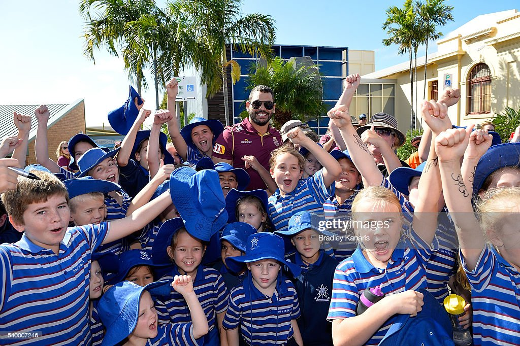 Greg Inglis poses for a group photo with young school kids during a Queensland Maroons State of Origin Fan Day on June 14, 2016 in Gladstone, Australia.