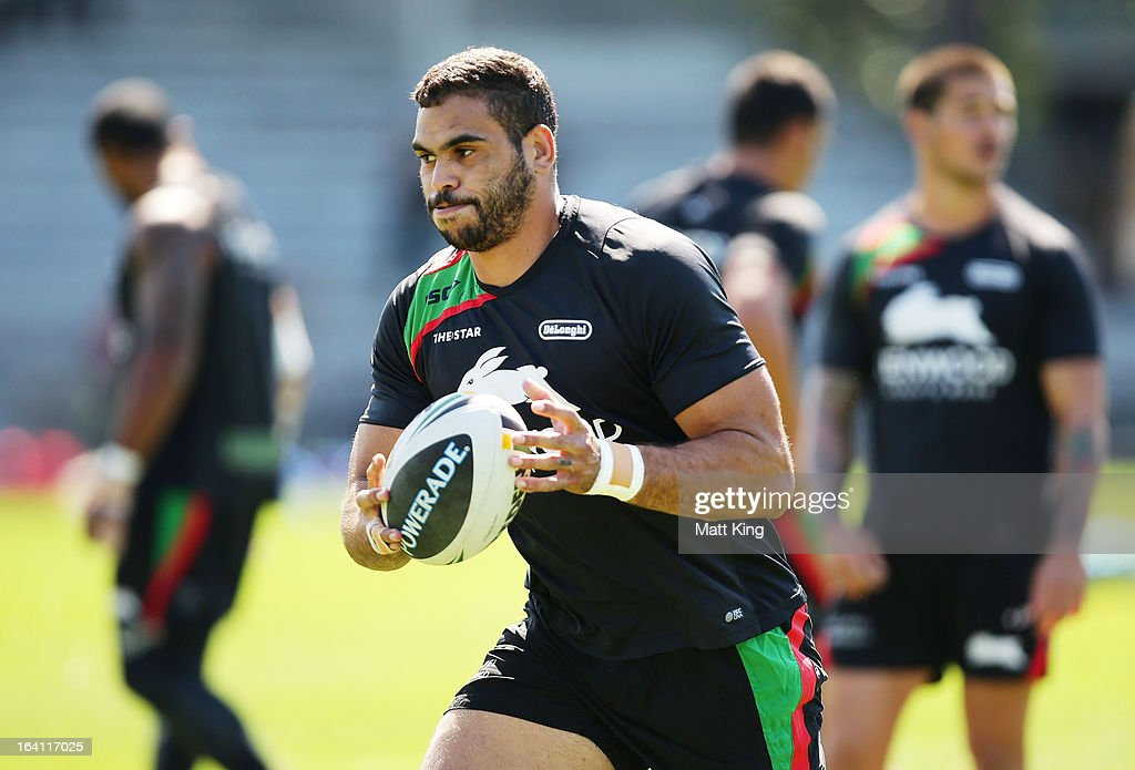 Greg Inglis runs with the ball during a South Sydney Rabbitohs NRL training session at Redfern Oval on March 20, 2013 in Sydney, Australia.