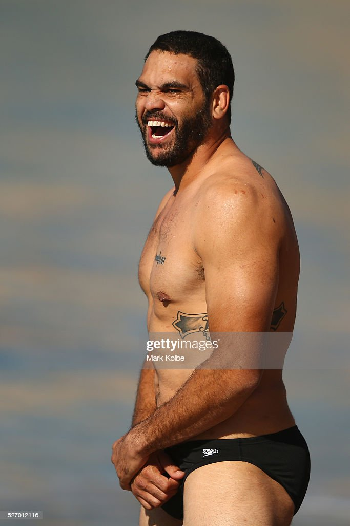 Greg Inglis shares a laugh with a team mate during the Australia Kangaroos Test team recovery session at Coogee Beach on May 2, 2016 in Sydney, Australia.