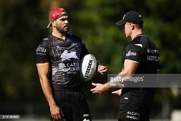 Greg Inglis talks to coach Michael Maguire during a South Sydney Rabbitohs NRL training session at Redfern Oval on April 5 2016 in Sydney Australia