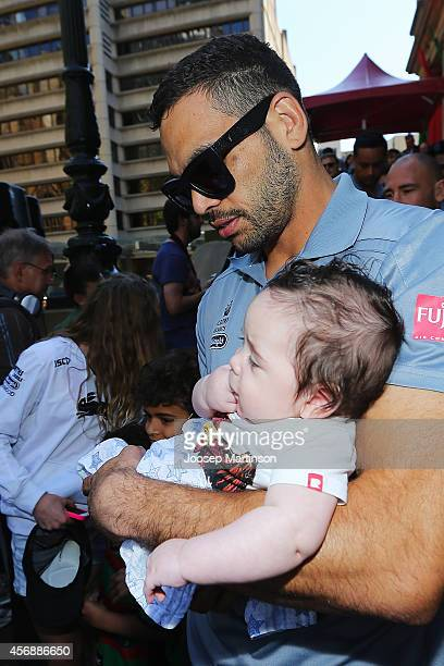Greg Inglis walks on with his baby boy Nate Alexander during a South Sydney Rabbitohs NRL Grand Final celebration at Sydney Town Hall on October 9...