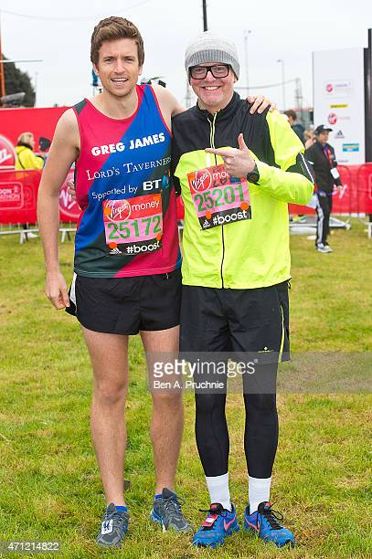 Greg James and Chris Evans poses for photographs at the celebrity start at The London Marathon 2015 on April 26 2015 in London England