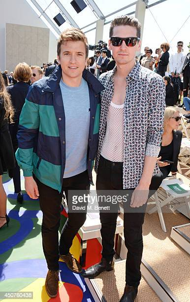 Greg James and George Craig attend the front row at Burberry Prorsum SS15 during London Collections Men at Kensington Gardens on June 17 2014 in...