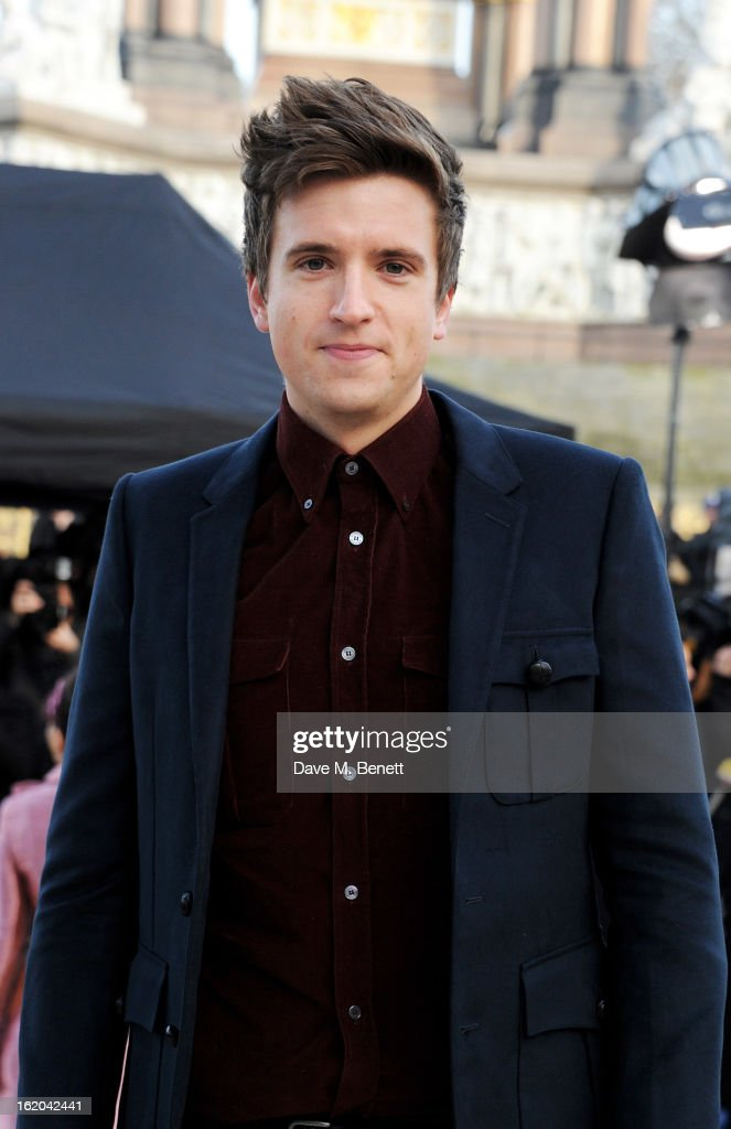 Greg James arrives at the Burberry Prorsum 2013 Autumn Winter Womenswear Show at Kensington Gardens on February 18, 2013 in London, England.