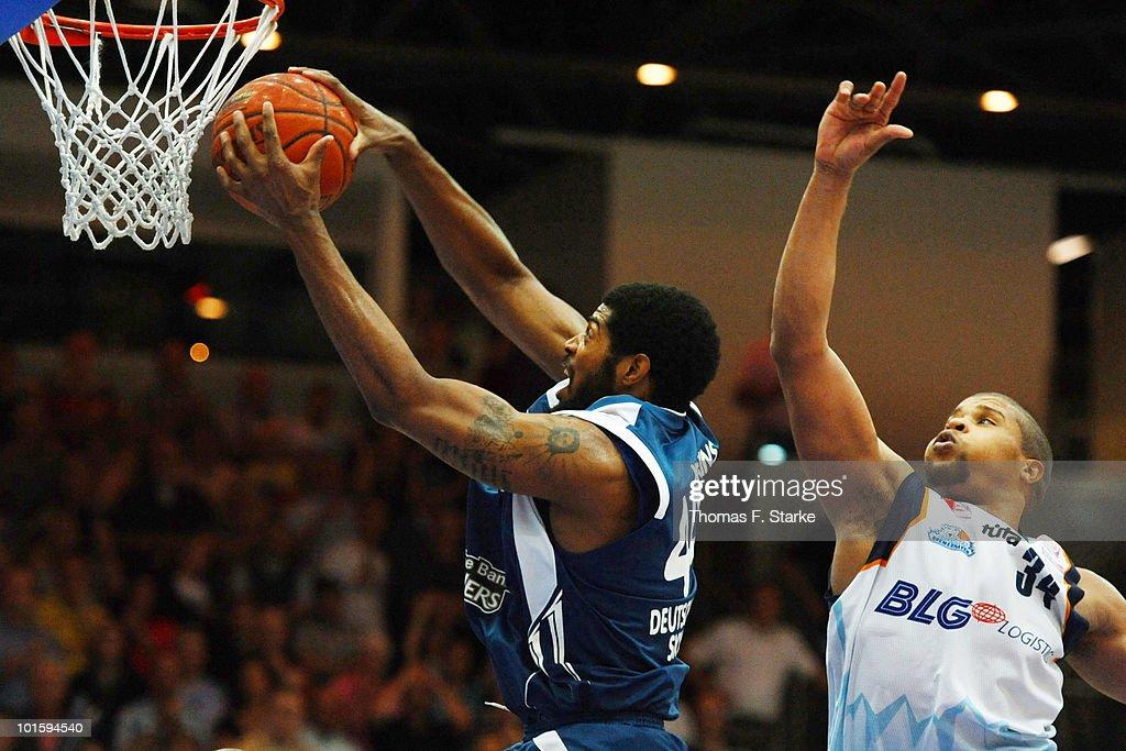 Greg Jenkins of Frankfurt and Jeff Gibbs of Bremerhaven in action during the Beko Basketball Bundesliga playoff match between Eisbaeren Bremerhaven...