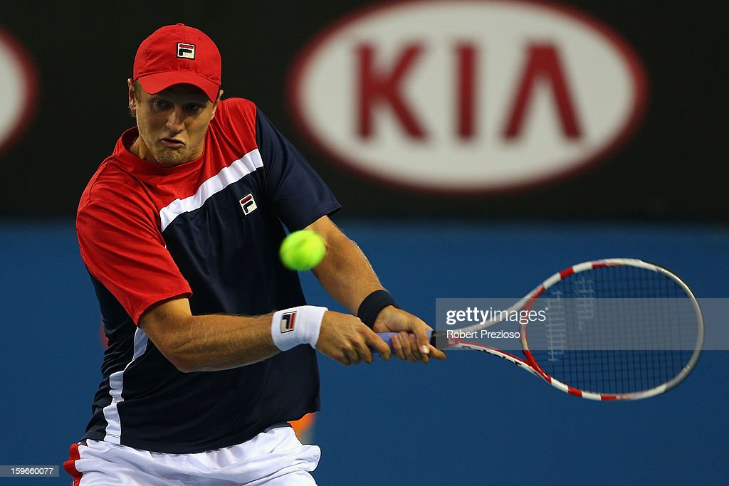 Greg Jones of Australia plays a backhand in his third round doubles match with Alex Bolt of Australia against Daniele Bracciali of Italy and Lukas Dlouhy of Czech Republic during day five of the 2013 Australian Open at Melbourne Park on January 18, 2013 in Melbourne, Australia.