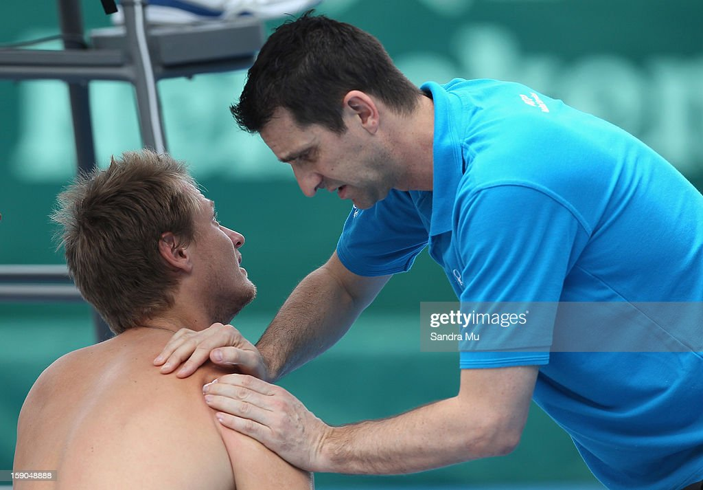 Greg Jones of Australia receives medical attention in his qualifying match against Victor Hanescu of Romania during day one of the Heineken Open at ASB Tennis Centre on January 7, 2013 in Auckland, New Zealand.