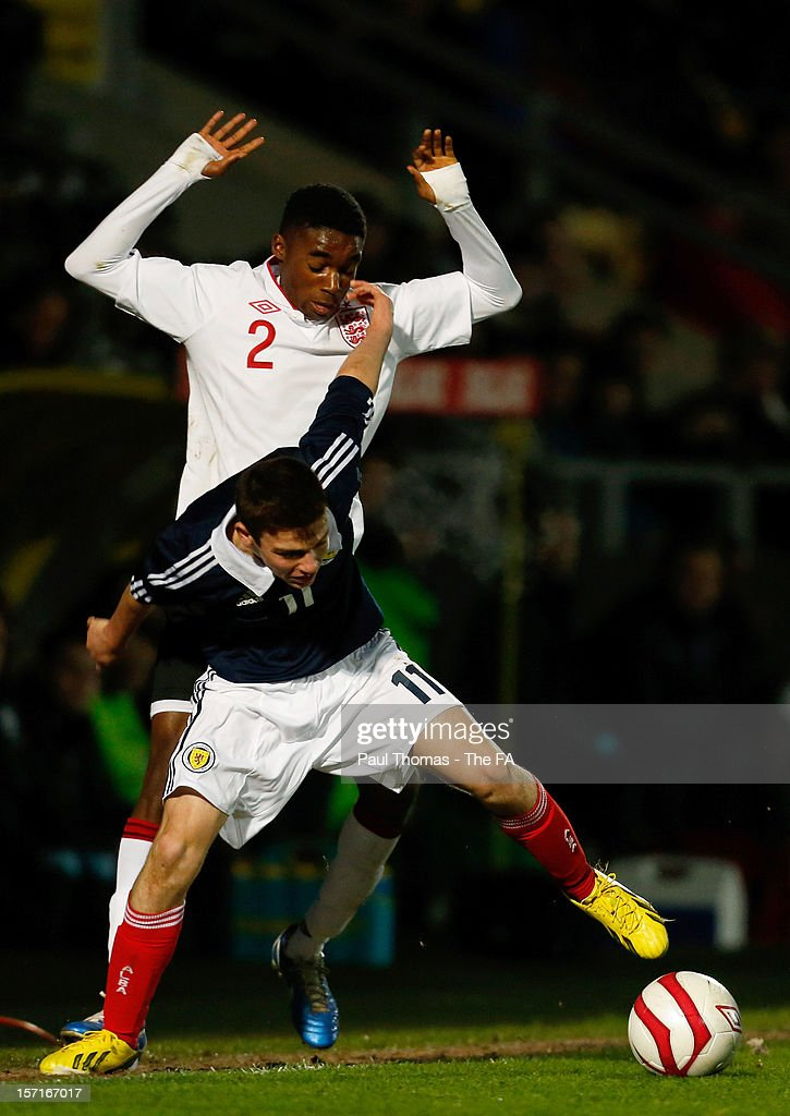 Greg Kiltie of Scotland U16 (front) vies with Mandela Egbo of England U16 during the Sky Sports Victory Shield match between England U16 and Scotland U16 at Pirelli Stadium on November 29, 2012 in Burton-upon-Trent, England.