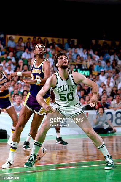Greg Kite of the Boston Celtics boxes out Kareem AbdulJabbar of the Los Angeles Lakers during a game circa 1984 at the Boston Garden in Boston...