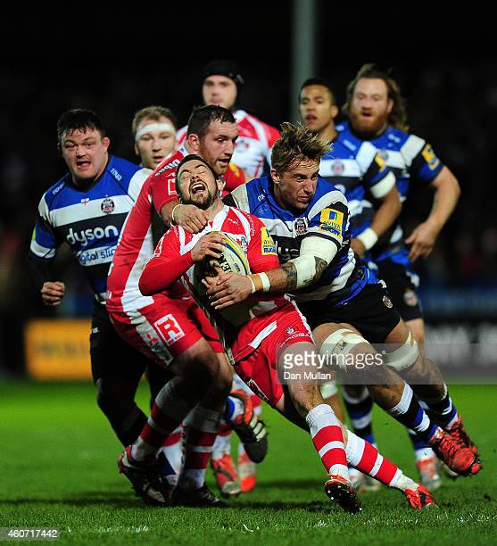 Greg Laidlaw of Gloucester is tackled by Dominic Day of Bath during the Aviva Premiership match between Gloucester Rugby and Bath Rugby at Kingsholm...