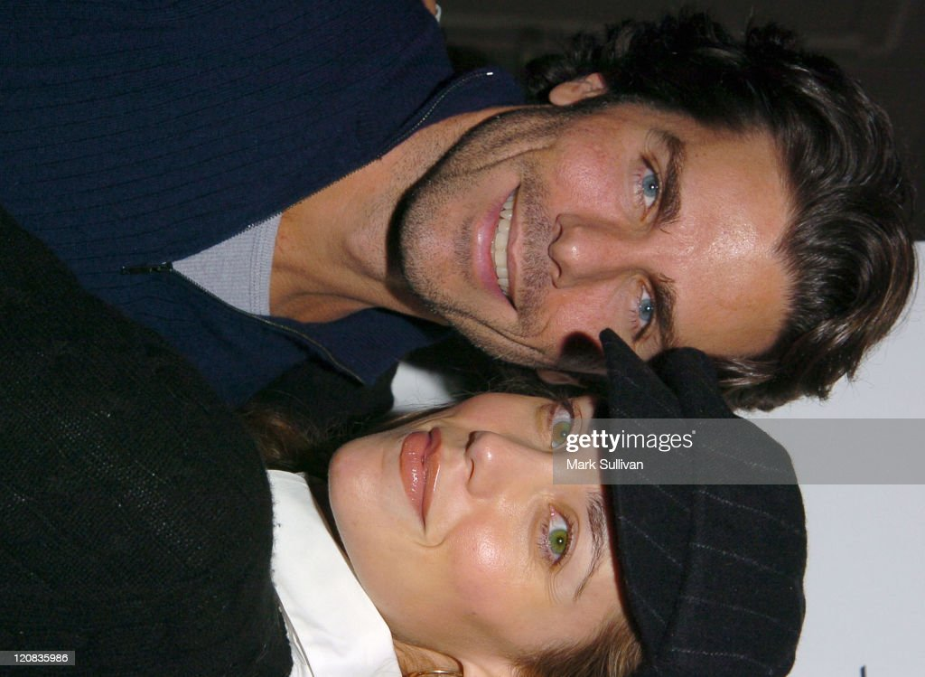 Greg Lauren and Elizabeth Berkley during Howard Fine's Winter Wonderful Holiday Party at Boardner's in Hollywood California United States