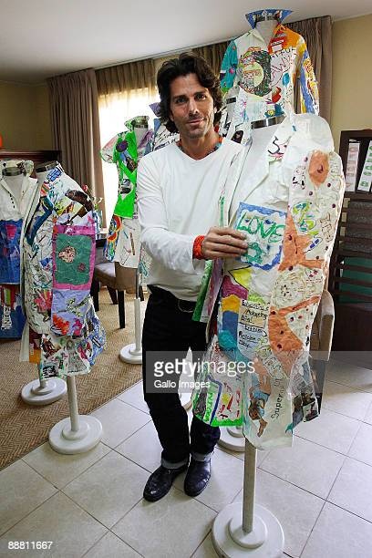 Greg Lauren newhew of fashion designer Ralph Lauren shows paper art made by girls who attended his workshop at the Oprah Winfrey Leadership Academy...