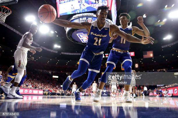 Greg Lee of the Cal State Bakersfield Roadrunners tries to grab a rebound during the second half of the college basketball game against the Arizona...