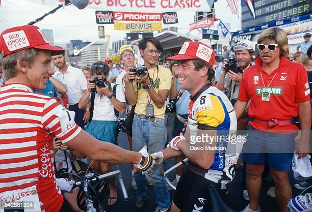 Greg Lemond of the USA shakes hands with Bernard Hinault of France during the Denver Criterium stage of the 1985 Coors Classic bicycle race on August...