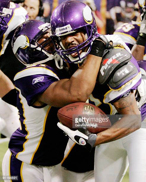 Greg Lewis of the Minnesota Vikings celebrates with teammate Visanthe Shiancoe after catching a 32yard pass for a touchdown with two seconds on the...