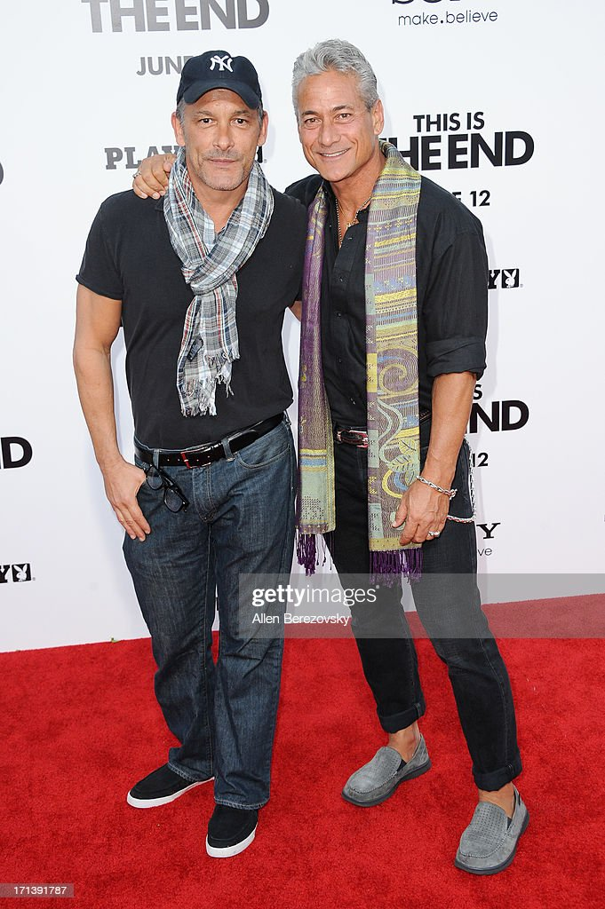 Greg Louganis (R) and Johnny Chaillot attend the premiere of Columbia Pictures' 'This Is The End' at Regency Village Theatre on June 3, 2013 in Westwood, California.