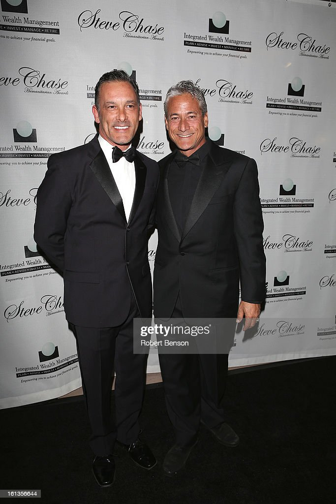 <a gi-track='captionPersonalityLinkClicked' href=/galleries/search?phrase=Greg+Louganis&family=editorial&specificpeople=217786 ng-click='$event.stopPropagation()'>Greg Louganis</a> (R) with Johnny Chaillot arrives at the 19th Annual Steve Chase Humanitarian Awards Gala at the Palm Springs Convention Center on February 9, 2013 in Palm Springs, California.