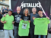 Greg Lyman Mayor of El Cerrito pose with Robert Trujillo James Hetfield Kirk Hammett and Lars Ulrich of Metallica after they receive a Proclamation...