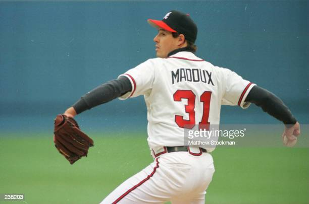 Greg Maddux of the Atlanta Braves pitches in the first inning of their home opener against the San Francisco Giants at Fulton County Stadium in...