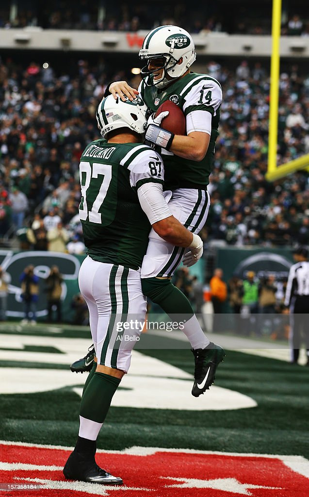 <a gi-track='captionPersonalityLinkClicked' href=/galleries/search?phrase=Greg+McElroy&family=editorial&specificpeople=5534586 ng-click='$event.stopPropagation()'>Greg McElroy</a> #14 of the New York Jets celebrates with Konrad Reuland #87 after throwing his first touchdown in the NFL to Jeff Cumberland #86 against the Arizona Cardinals during their game at at MetLife Stadium on December 2, 2012 in East Rutherford, New Jersey. The Jets won 7-6.