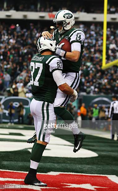 Greg McElroy of the New York Jets celebrates with Konrad Reuland after throwing his first touchdown in the NFL to Jeff Cumberland against the Arizona...