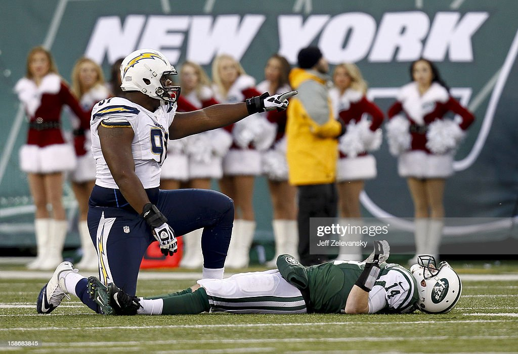 Greg McElroy #14 of the New York Jets lies on the turf after being sacked by Kendall Reyes #91 of the San Diego Chargers at MetLife Stadium on December 23, 2012 in East Rutherford, New Jersey.