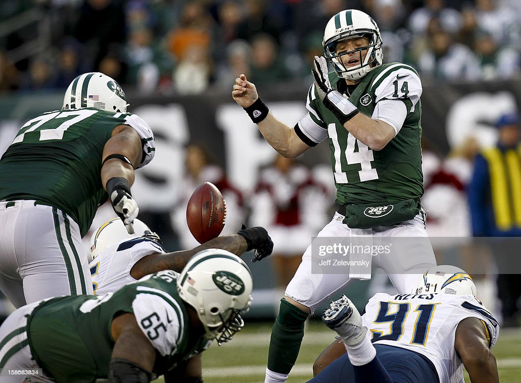 <a gi-track='captionPersonalityLinkClicked' href=/galleries/search?phrase=Greg+McElroy&family=editorial&specificpeople=5534586 ng-click='$event.stopPropagation()'>Greg McElroy</a> #14 of the New York Jets loses the ball in front of Kendall Reyes #91 of the San Diego Chargers at MetLife Stadium on December 23, 2012 in East Rutherford, New Jersey.