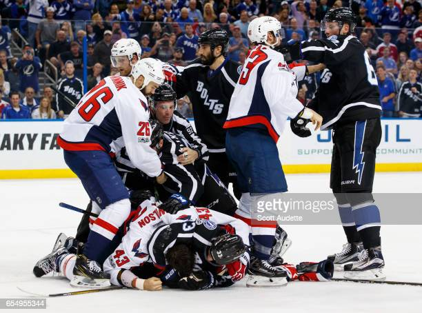 Greg McKegg Jason Garrison and Andrej Sustr of the Tampa Bay Lightning engage in an altercation with Daniel Winnik Jay Beagle and Tom Wilson of the...