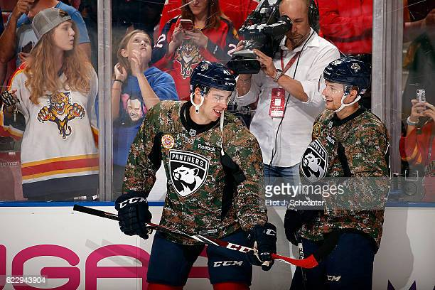 Greg McKegg of the Florida Panthers and teammate Kyle Rau sport camo warm up jerseys for Military appreciation night prior to the start of the game...