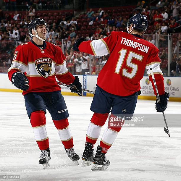 Greg McKegg of the Florida Panthers celebrates his goal with teammate Paul Thompson during the first period against the Nashville Predators at the...