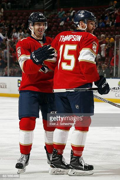 Greg McKegg of the Florida Panthers celebrates his goal with teammate Paul Thompson against the Nashville Predators at the BBT Center on January 6...