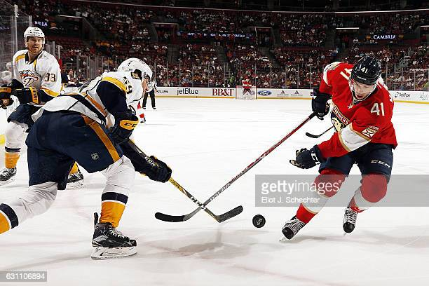Greg McKegg of the Florida Panthers crosses sticks with Roman Josi of the Nashville Predators at the BBT Center on January 6 2017 in Sunrise Florida