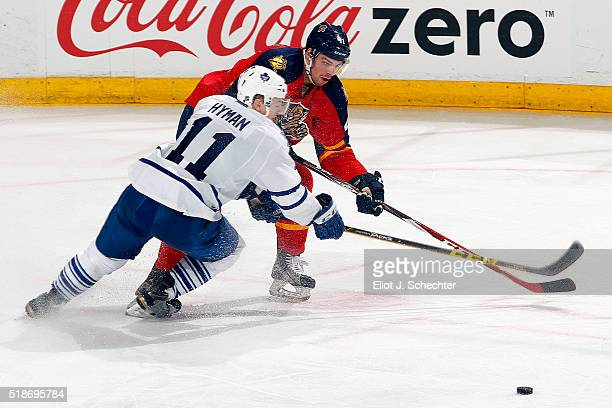 Greg McKegg of the Florida Panthers crosses sticks with Zach Hyman of the Toronto Maple Leafs at the BBT Center on March 29 2016 in Sunrise Florida