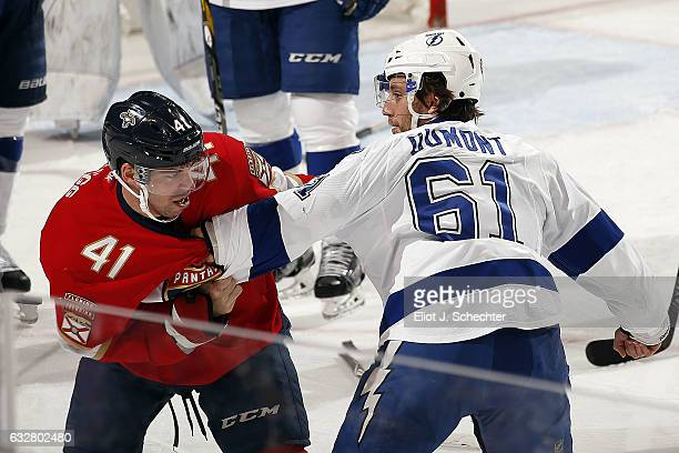 Greg McKegg of the Florida Panthers fights with Gabriel Dumont of the Tampa Bay Lightning at the BBT Center on January 26 2017 in Sunrise Florida