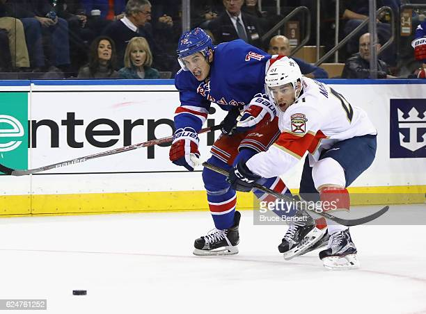 Greg McKegg of the Florida Panthers holds back Brady Skjei of the New York Rangers at Madison Square Garden on November 20 2016 in New York City The...