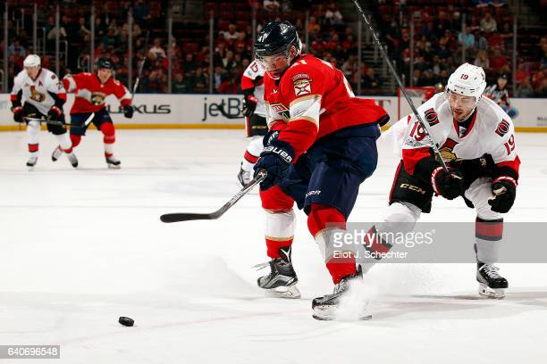 Greg McKegg of the Florida Panthers tangles with Derick Brassard of the Ottawa Senators at the BBT Center on January 31 2017 in Sunrise Florida